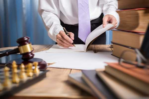 attorney-reviewing-business-insurance-policy